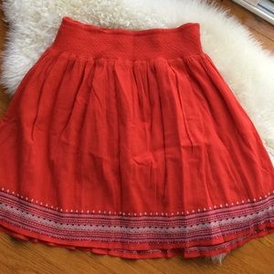 Red Colton skirt with embroidery detail